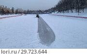 Купить «Snow plows clearing a ice rink during after a blizzard», видеоролик № 29723644, снято 18 июня 2019 г. (c) Константин Шишкин / Фотобанк Лори