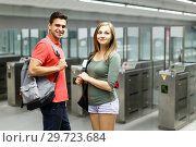 Купить «Couple is standing near turnstiles and moving around the city», фото № 29723684, снято 14 июня 2018 г. (c) Яков Филимонов / Фотобанк Лори