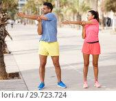 Купить «Couple training outdoors», фото № 29723724, снято 26 июня 2018 г. (c) Яков Филимонов / Фотобанк Лори