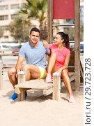 Купить «Sporty couple posing after outdoors workout», фото № 29723728, снято 26 июня 2018 г. (c) Яков Филимонов / Фотобанк Лори