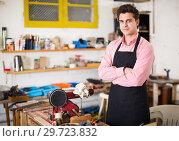 Купить «Joiner working on machine», фото № 29723832, снято 8 апреля 2017 г. (c) Яков Филимонов / Фотобанк Лори