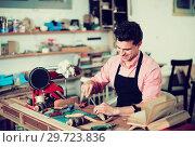 Купить «Craftsman in uniform working in carpentry», фото № 29723836, снято 8 апреля 2017 г. (c) Яков Филимонов / Фотобанк Лори