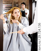 Купить «Young woman is not happy with her hair», фото № 29724136, снято 7 марта 2017 г. (c) Яков Филимонов / Фотобанк Лори