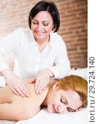 Купить «Adult masseuse working in salon», фото № 29724140, снято 7 марта 2017 г. (c) Яков Филимонов / Фотобанк Лори