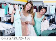 Купить «Customers looking for new garments», фото № 29724156, снято 19 июня 2017 г. (c) Яков Филимонов / Фотобанк Лори