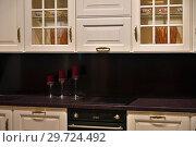 Купить «Beige kitchen set with stove in the room», фото № 29724492, снято 25 ноября 2018 г. (c) Володина Ольга / Фотобанк Лори