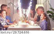 Купить «happy family having dinner party at home», видеоролик № 29724616, снято 7 января 2019 г. (c) Syda Productions / Фотобанк Лори