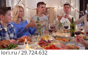 Купить «happy family having dinner party at home», видеоролик № 29724632, снято 14 января 2019 г. (c) Syda Productions / Фотобанк Лори