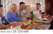 Купить «happy family having dinner party at home», видеоролик № 29724640, снято 7 января 2019 г. (c) Syda Productions / Фотобанк Лори