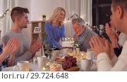 Купить «happy family having birthday party at home», видеоролик № 29724648, снято 7 января 2019 г. (c) Syda Productions / Фотобанк Лори