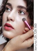 Купить «Make-up artist apply beauty makeup on the face of a beautiful girl. Visagist with makeup brush in hand», фото № 29729160, снято 22 марта 2018 г. (c) Serg Zastavkin / Фотобанк Лори