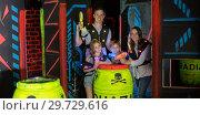 Купить «Parents and children playing laser tag», фото № 29729616, снято 6 июня 2018 г. (c) Яков Филимонов / Фотобанк Лори