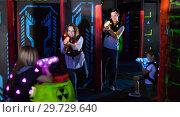 Купить «Kids with parents during lasertag game», фото № 29729640, снято 6 июня 2018 г. (c) Яков Филимонов / Фотобанк Лори