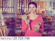 Купить «girl buying candies at shop», фото № 29729748, снято 22 марта 2017 г. (c) Яков Филимонов / Фотобанк Лори