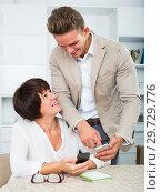 Купить «Son telling mature mother how to use phone», фото № 29729776, снято 8 июля 2020 г. (c) Яков Филимонов / Фотобанк Лори