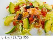 Купить «Closeup of salad with fried salmon, avocado, tomatoes and lettuce», фото № 29729956, снято 17 января 2019 г. (c) Яков Филимонов / Фотобанк Лори