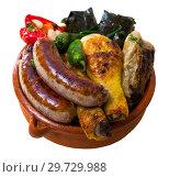 Купить «Kapama a dish of bulgarian cuisine with assortiment meat, grape rolls», фото № 29729988, снято 17 января 2019 г. (c) Яков Филимонов / Фотобанк Лори