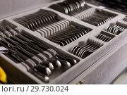 Купить «Image of cutlery on the table», фото № 29730024, снято 2 мая 2018 г. (c) Яков Филимонов / Фотобанк Лори