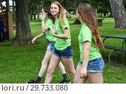 Купить «8th Grade Girls Walking in Park, Wellsville, New York, USA.», фото № 29733080, снято 7 июня 2018 г. (c) age Fotostock / Фотобанк Лори