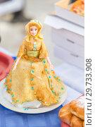 Купить «Russia, Samara, February 2018: Porcelain doll in an interesting dress of pancakes in the park at the celebration of Maslenitsa.», фото № 29733908, снято 18 февраля 2018 г. (c) Акиньшин Владимир / Фотобанк Лори