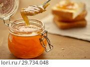 Купить «Toasts and orange jam in a glass jar», фото № 29734048, снято 5 июня 2018 г. (c) Елена Вишневская / Фотобанк Лори