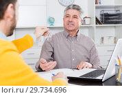 Купить «Mature man and agent sign rental agreement», фото № 29734696, снято 22 января 2019 г. (c) Яков Филимонов / Фотобанк Лори