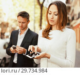 Купить «Young man and woman phubbing», фото № 29734984, снято 11 апреля 2017 г. (c) Яков Филимонов / Фотобанк Лори