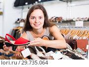 Young woman choosing shoes in store. Стоковое фото, фотограф Яков Филимонов / Фотобанк Лори