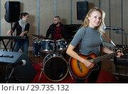 Купить «Great guitar player and singer with band», фото № 29735132, снято 26 октября 2018 г. (c) Яков Филимонов / Фотобанк Лори