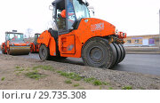 Купить «Work on laying the asphalt surface on a city street», видеоролик № 29735308, снято 25 марта 2019 г. (c) FotograFF / Фотобанк Лори