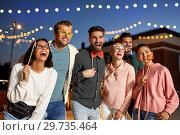 Купить «happy friends with party props at rooftop», фото № 29735464, снято 2 сентября 2018 г. (c) Syda Productions / Фотобанк Лори