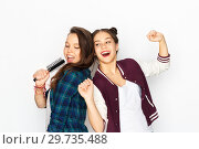 Купить «teenage girls singing to hairbrush and having fun», фото № 29735488, снято 19 декабря 2015 г. (c) Syda Productions / Фотобанк Лори