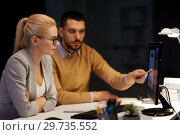 Купить «designers with mockup on computer screen at office», фото № 29735552, снято 26 ноября 2017 г. (c) Syda Productions / Фотобанк Лори
