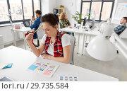 Купить «creative woman working on user interface at office», фото № 29735584, снято 1 апреля 2018 г. (c) Syda Productions / Фотобанк Лори