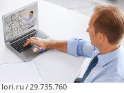 Купить «businessman watching webinar on laptop at office», фото № 29735760, снято 9 июня 2013 г. (c) Syda Productions / Фотобанк Лори