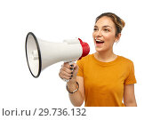 Купить «young woman or teenage girl with megaphone», фото № 29736132, снято 10 ноября 2018 г. (c) Syda Productions / Фотобанк Лори