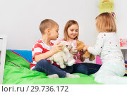Купить «happy children playing with soft toys at home», фото № 29736172, снято 15 октября 2017 г. (c) Syda Productions / Фотобанк Лори
