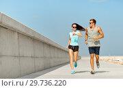 Купить «couple in sports clothes running outdoors», фото № 29736220, снято 1 августа 2018 г. (c) Syda Productions / Фотобанк Лори