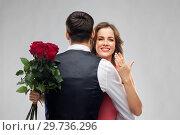 Купить «woman with engagement ring and roses hugging man», фото № 29736296, снято 30 ноября 2018 г. (c) Syda Productions / Фотобанк Лори