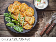 Купить «potato pancakes with sour cream on wooden table», фото № 29736480, снято 13 января 2019 г. (c) Майя Крученкова / Фотобанк Лори