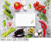 Купить «Notebook with vegetables and herbs on gray concrete background», фото № 29737040, снято 14 июля 2017 г. (c) Ольга Сергеева / Фотобанк Лори