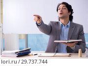 Купить «Young handsome teacher in front of whiteboard», фото № 29737744, снято 20 ноября 2018 г. (c) Elnur / Фотобанк Лори