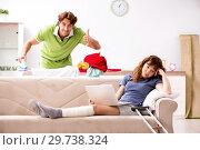 Купить «Husband helping leg injured wife in housework», фото № 29738324, снято 4 октября 2018 г. (c) Elnur / Фотобанк Лори