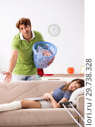 Купить «Husband helping leg injured wife in housework», фото № 29738328, снято 4 октября 2018 г. (c) Elnur / Фотобанк Лори