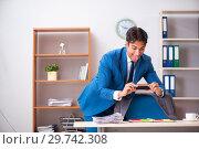 Купить «Employee stealing important information in industrial espionage», фото № 29742308, снято 10 августа 2018 г. (c) Elnur / Фотобанк Лори