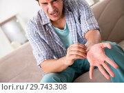 Купить «Young man committing suicide with razor blade», фото № 29743308, снято 25 сентября 2018 г. (c) Elnur / Фотобанк Лори