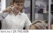 Купить «Woman Hairdresser Makes Professional Styling With A Spray», видеоролик № 29743608, снято 20 мая 2019 г. (c) Pavel Biryukov / Фотобанк Лори