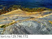 Купить «Beautiful rocks on the shore of the White Sea . Bay Chupa, Karelia, Russia», фото № 29746172, снято 10 августа 2018 г. (c) Сергей Трофименко / Фотобанк Лори