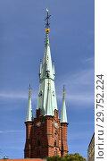 Купить «Church of Saint Clare or Klara Church, church in central Stockholm. Tower was built as part of restoration work in 1880s. Sweden», фото № 29752224, снято 9 июля 2018 г. (c) Валерия Попова / Фотобанк Лори