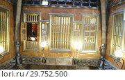 Купить «Rich interior furnishings of Guell Palace designed by Catalan architect Antoni Gaudi», видеоролик № 29752500, снято 2 сентября 2018 г. (c) Яков Филимонов / Фотобанк Лори